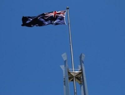 Australian Flag against a Clear Blue Sky - Parliament House