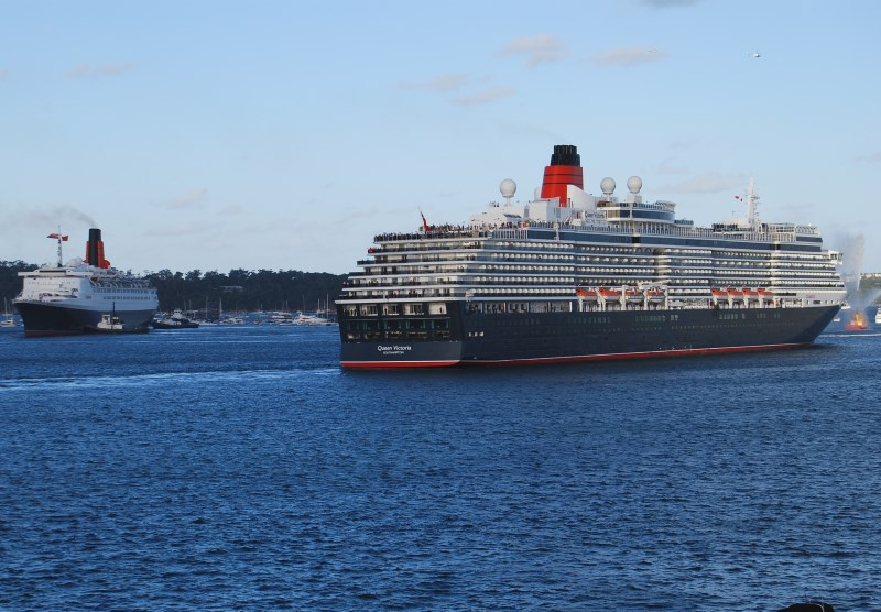 Cunard's Queen Victoria and the Queen Elizabeth Liners passing on Sydney Harbour.