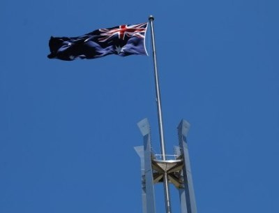 Australian Flag against a Clear Blue Sky - Parliament House