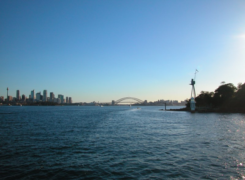 View of the City on the Harbour and Bradleys Head with the masthead of the HMAS Sydney.