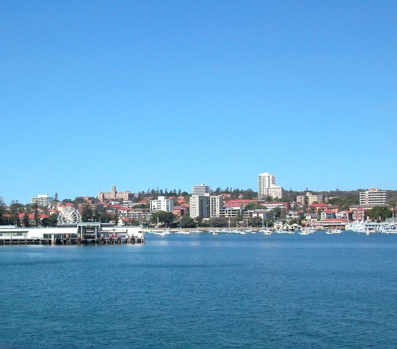 The Beach at Little Manly, with lots of boats and yachts. Manly Wharf is on the left.