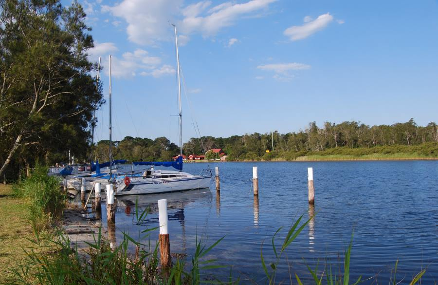 The Sussex Inlet connects St Georges Basin and the Ocean. Just opposite is Booderee National Park.