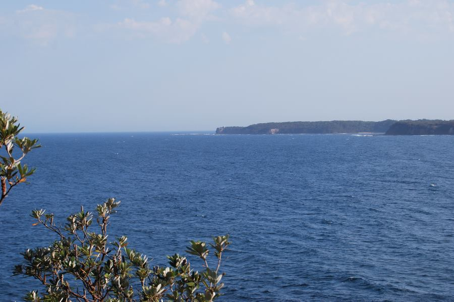 Warden Head with the lighthouse in the center of the photo, Ulladulla