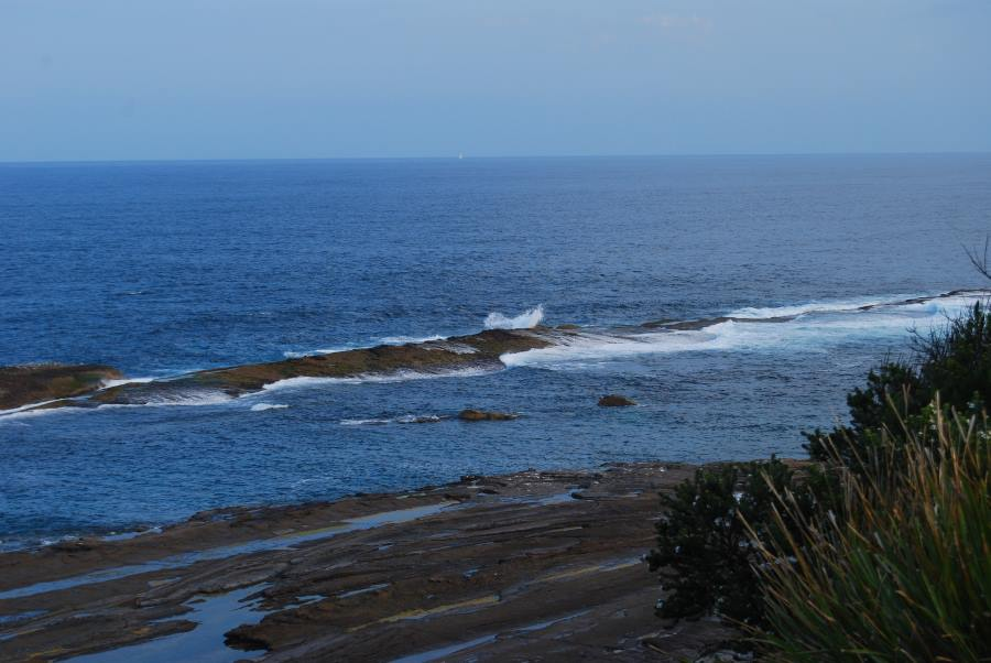 Over the millenia, layers of lava and sandstone still influence the coastline and protect offshore islands