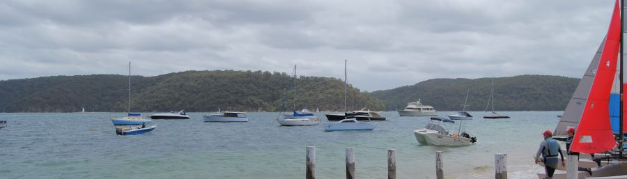 Boats on the Pittwater. The Kuringai-Chase National Park is in the Background.