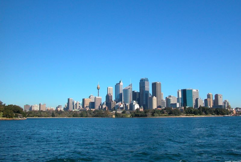Farm Cove and the Royal Botanic Garden as seen from Sydney Harbour, with the City in the Background