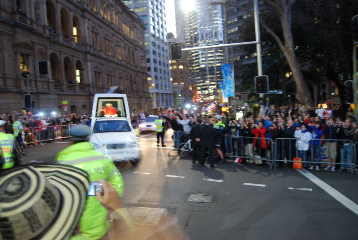 The Motorcade arrives, albeit a bit fast. The crowds cheered, the Pope waved and all were happy. The photographer, however, was not quite ready, but the picture still captures the emotion in the failing winter evening light.