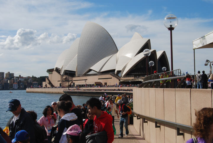 People get a view of the Pope on Sydney Harbour during World Youth Day Celebrations