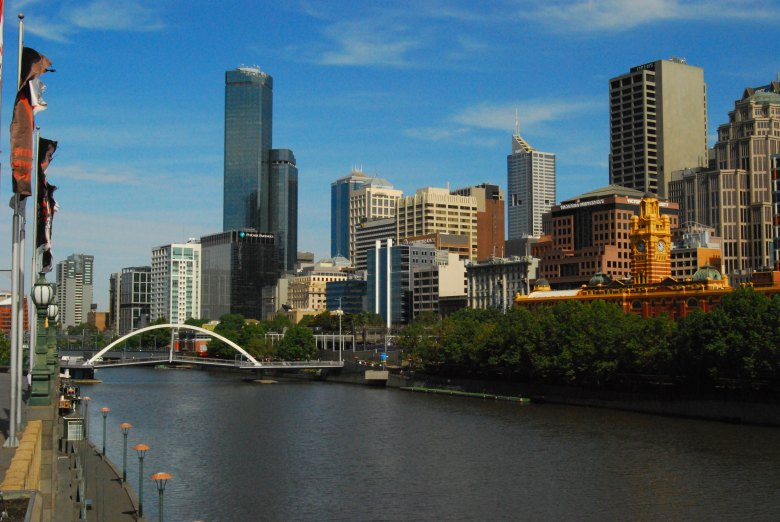 Rialto Towers loom above the Melbourne Skyline and the Yarra River