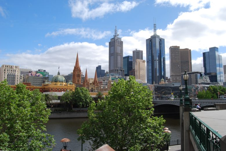 Federation Square from the other side of the Yarra River, on the left is Flinders St Train Station and in the background, St. Pauls Cathedral